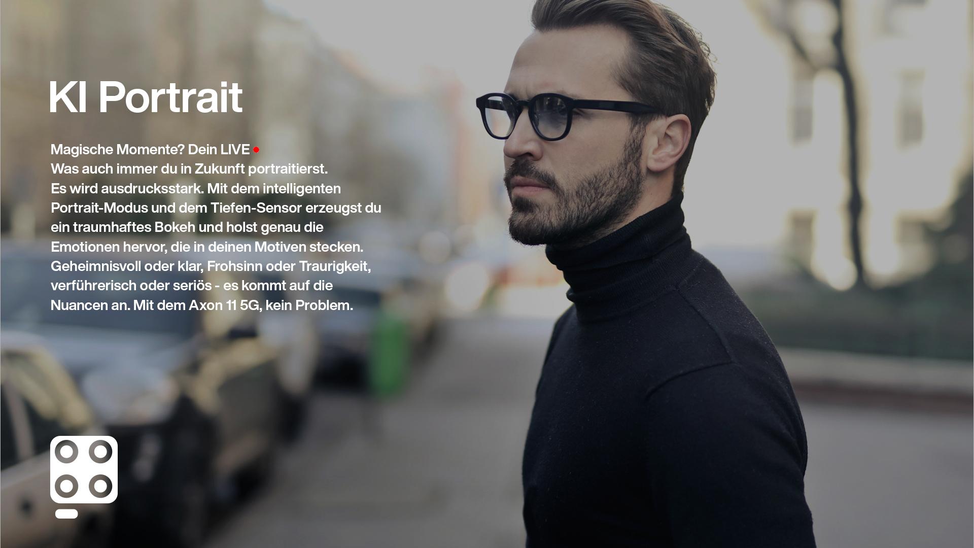 mann mit brille im fokus vor unscharfem hintergrund